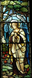 An angel in the Compton Window in the South Transept of All Saints, Minstead