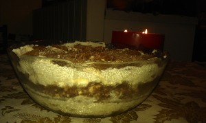 Christmas Cranachan in a bowl with with a Christmas candle