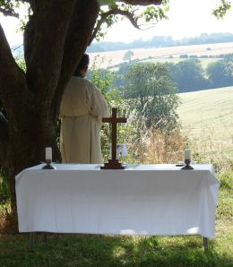 Priest at Prayer - an image from our 'elemental' outdoor Eucharist during summer school. Other images of this service and local wildlife can be found in my Flickr account, accessed via the right-hand column.