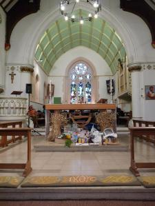 The Nave Altar at St. Peter's Mill End, Rickmansworth, with all the harvest gifts that were brought up and some talk props!