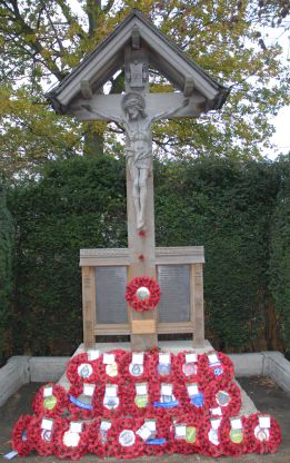 The War Memorial in Yateley, photographed after Remembrance Day 2010 showing the fresh wooden plaque with marks Adam's place among those whom Yateley remember each year.