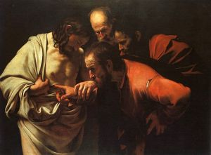Caravagio's 'The incredulity of Saint Thomas'.  Although today commentators think that Thomas did not in fact touch Jesus' wounds as it is not mentioned in scripture that he did, it was a long-held view that he did. (Wiki Commons http://en.wikipedia.org/wiki/File:Caravaggio_-_The_Incredulity_of_Saint_Thomas.jpg)