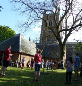 Maypole dancing at St. Peter's Church in the centre of St. Alban's, part of their Forest Church celebrations of may Day and Mary-Tide on 3rd May 2014