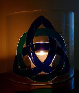 A Triquetra (the symbol of the Holy Trinity) by whose power we live in the circle of life and love in this world.